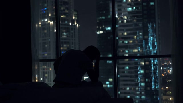 sad-unhappy-man-sitting-by-window-during-night-4k_htu-f7bge_thumbnail-medium09
