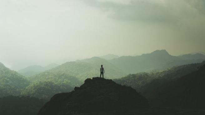 mountains-man-standing-peak